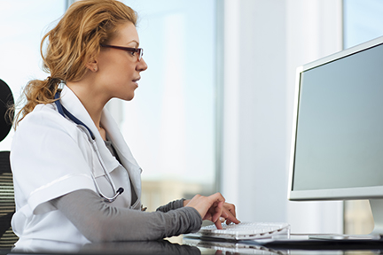 Female doctor on computer